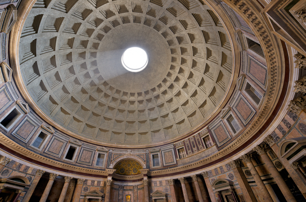 "Inside the Pantheon (""to every god"") temple in Rome, Italy. Natural light enters the oculus (eye) in the center of the dome."
