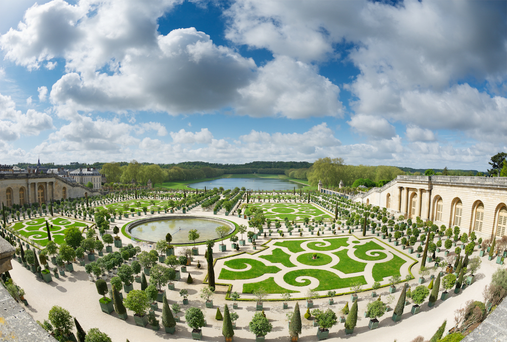 Paris, France - May 12, 2013: Springtime in the gardens of the Palace of Versailles - one of France's many national monuments (administered by the state) and a (UNESCO) World Heritage Site.